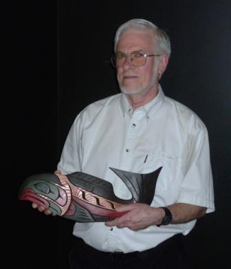 Pierre Legendre with a commemorative fish sculpture presented at the CSEE Kelowna conference, following the 2013 President's Award address.